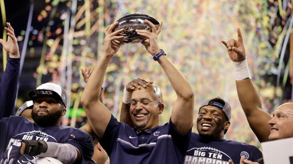 Coach James Franklin celebrates with his Nittany Lions after winning the Big Ten title in Indianapolis. Next stop? The Lions put their nine-game winning streak on the line vs. USC in the Rose Bowl.