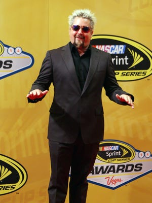 TV Personality Guy Fieri stands on the red carpet prior to the NASCAR Sprint Cup Series Awards. This weekend, he officiated gay marriages in Miami.