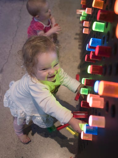 One-year-old Violet Mick enjoys the blinking lights