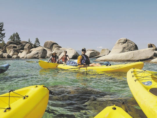 In 2017: Kayaking guide Sander Van Tel gives some last-minute instructions before heading out onto Lake Tahoe, which is battling a growing algae problem, during a four-hour kayak tour along the east shore.