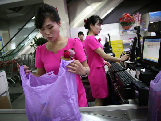 Cashiers work at the Potonggang department store in