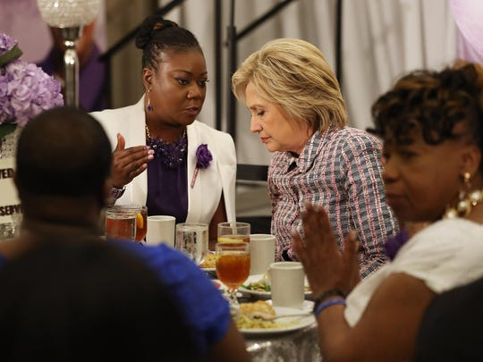 Democratic presidential candidate Hillary Clinton sits with Sybrina Fulton (L) , mother of Trayvon Martin who was fatally shot by neighborhood watch volunteer George Zimmerman in 2012, as she attends the third annual Circle of Mothers conference on May 21, 2016 in Fort Lauderdale, Florida.