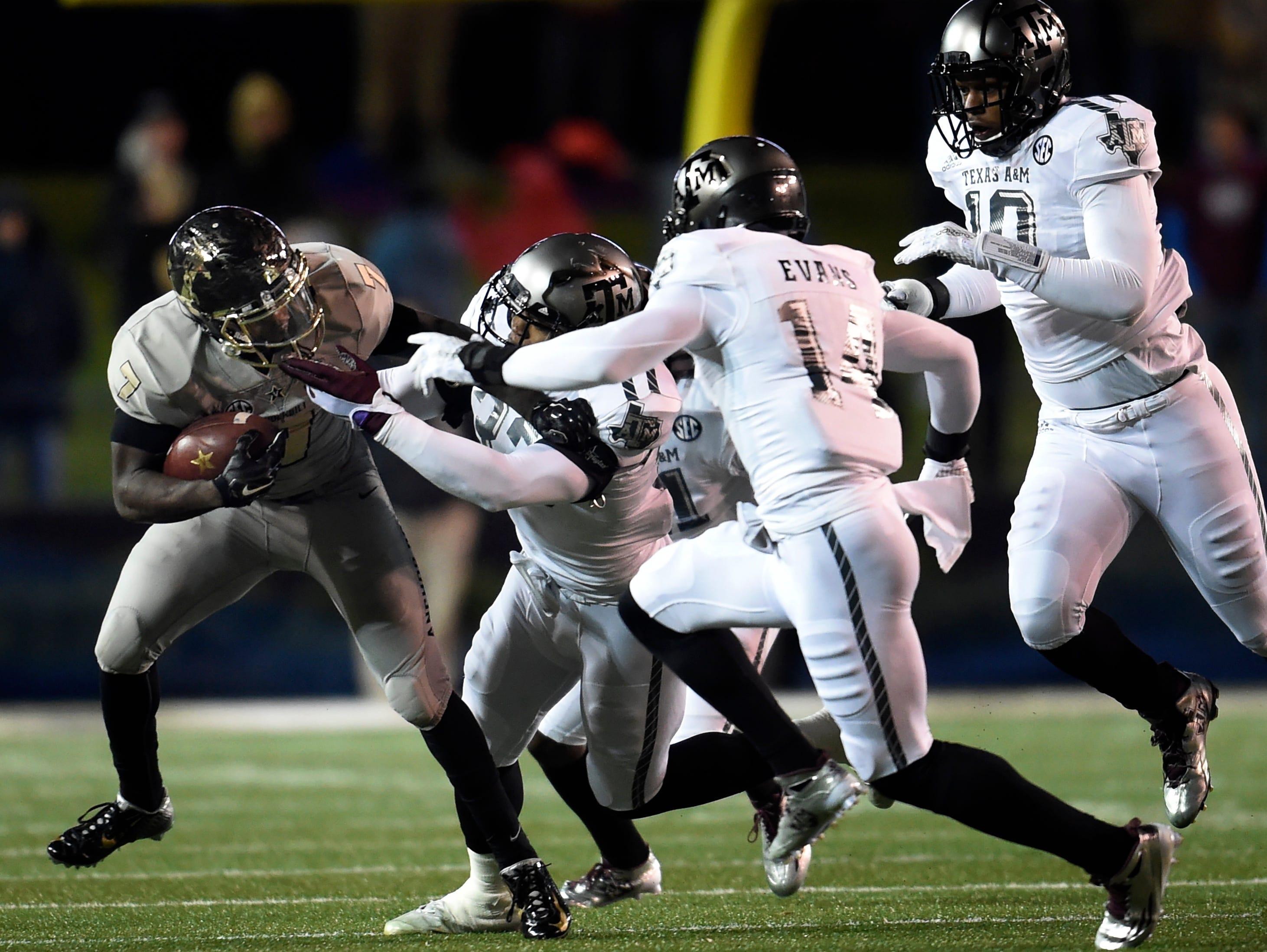 Vanderbilt running back Ralph Webb (7) tries to pull away from the Texas A&M defense on Nov. 21, 2015.