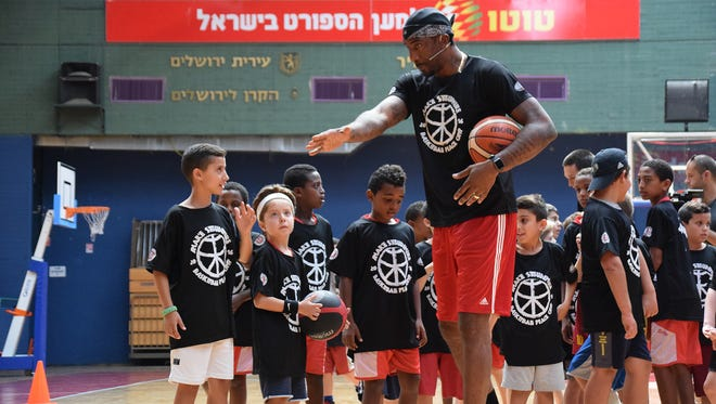 Amar'e Stoudemire instructs campers during his first annual peace camp in Israel.