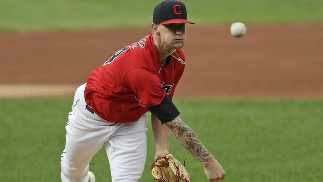 Cleveland Indians starting pitcher Zach Plesac delivers in the first inning in a baseball game against the Chicago White Sox, Wednesday, July 29, 2020, in Cleveland.