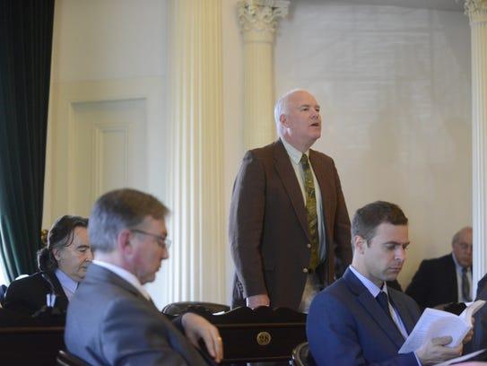 Sen. Joe Benning, R-Caledonia, rises to explain why