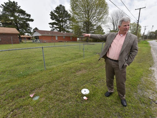 Attorney Reid Stanford stands next to a groundwater