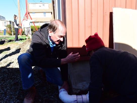 Erik Koskinen, of Allendale, volunteers with Habitat