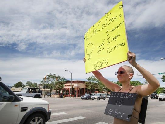 Former Fort Collins resident Brit Hoagland protests