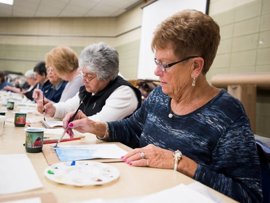 Pat Dunn, of Port Huron, works on her water color painting