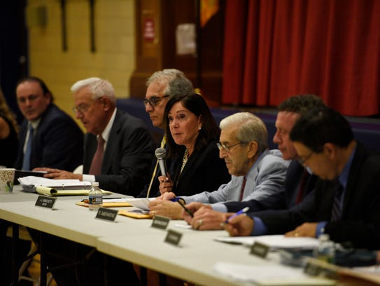 Upper Saddle River Mayor Joanne Minichetti, center,
