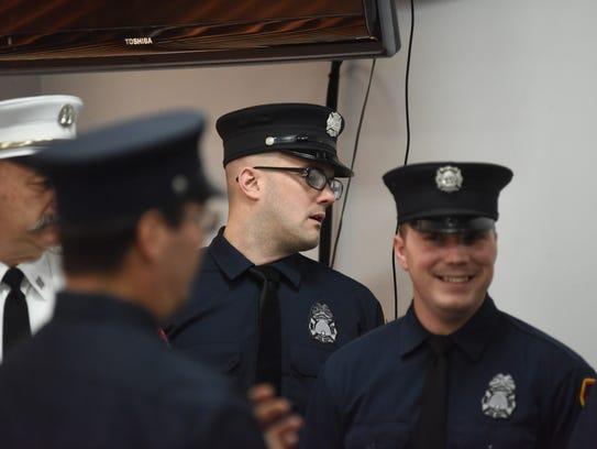 Firefighter Paul Bucher lines up after receiving the