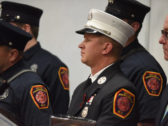 Cpt. Stephen Bauer receives the City of Poughkeepsie