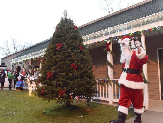 Santa Claus (Chris Llanes) greets the crowd on Saturday.