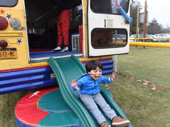 Sebastian Baez, 4, goes down the slide on Saturday.
