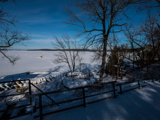 A power boat lies frozen in the ice on Malletts Bay