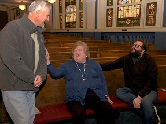 Former Calvary Baptist Church pastor Rev. John Bashier, left, talks with current Calvary pastor, the Rev. Linda A. Smith, and worship arts pastor, John Mark Coon, right, in the sanctuary of Calvary on West Capitol Street in Jackson.