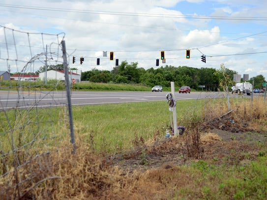 A cross for Bill Allman stands along U.S. 33 near Pickerington
