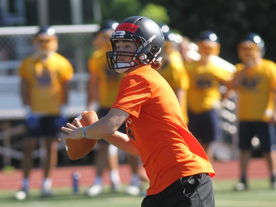 Anderson  quarterback Jay Volpenhein gets some reps
