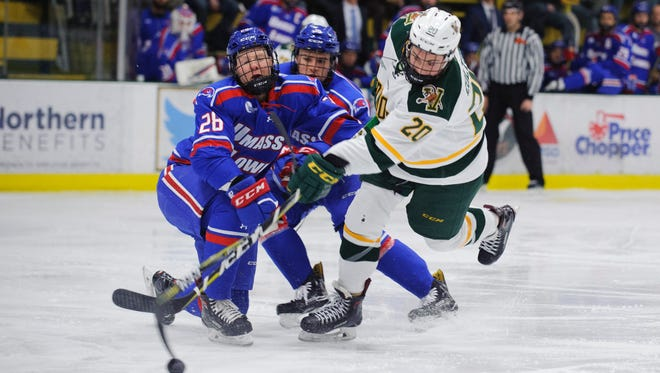 Vermont forward Ross Colton (20) takes a shot past UMass Lowell's Mattias Goransson (26) during the men's hockey game between the UMass-Lowell River Hawks and the Vermont Catamounts at Gutterson Fieldhouse on Friday night January 19, 2018 in Burlington.