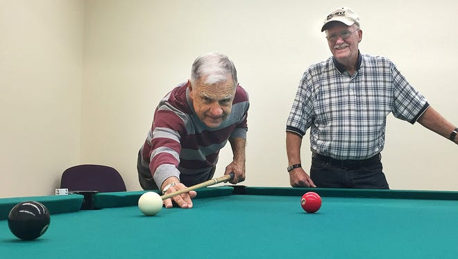 Sauk Rapids resident Bob Neale, at left, and Chuck Teal play pool at Whitney Senior Center in December 2015.