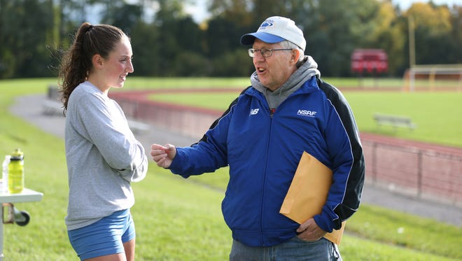 Coach Dave Hennessey talks with senior Tori Fahrenholz at a recent practice.