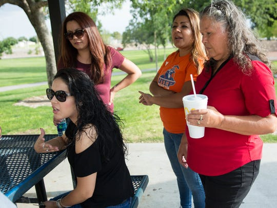 Michelle Zamora, left, along with other members of the Sedillo family, talk about her uncle Ernesto Sedillo, at Young Park, Thursday July 20, 2017. Ernesto was killed Monday in an altercation with a Las Cruces police officer.