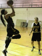 Alamogordo's Faith Silva, left, attempts a layup during practice.