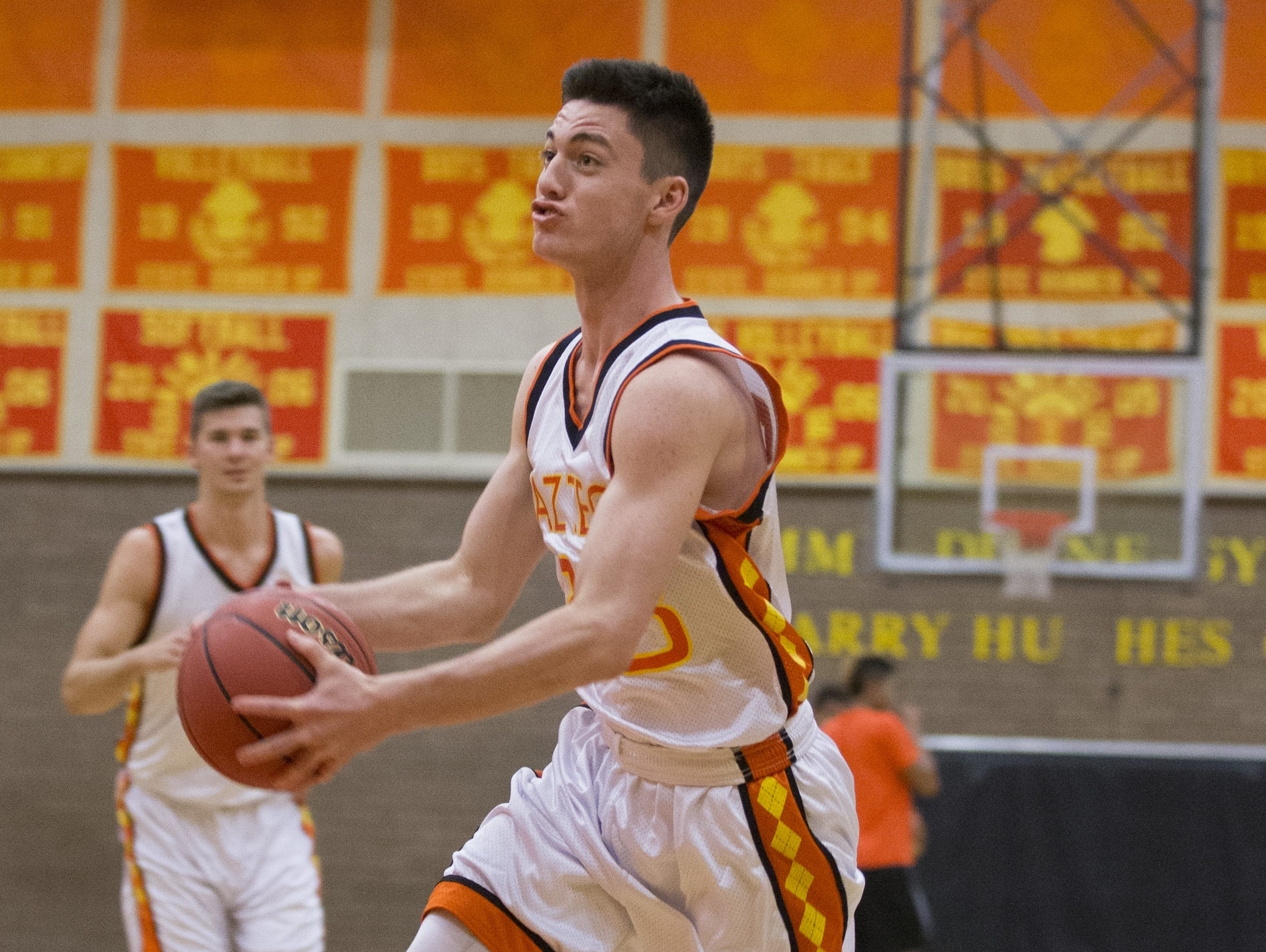Corona del Sol basketball player Alex Barcello goes up for a layup while playing two on two at the school's gym in Tempe on April 16, 2015.