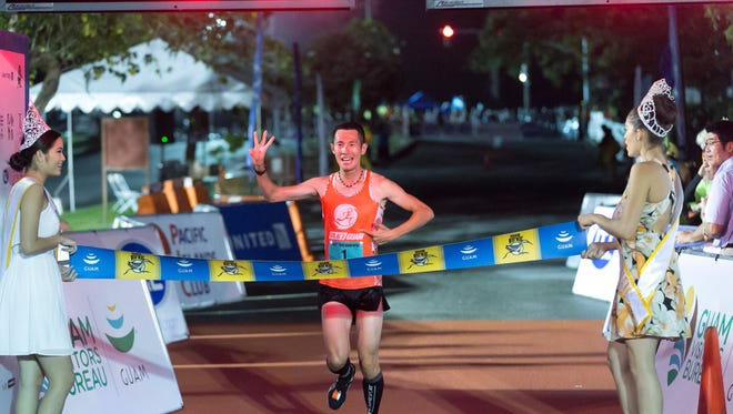 Tsukasa Kawarai finishes first for the male category during the 10th Annual Guam Ko'ko' Half-Marathon and Ekiden Relay race held at Governor Joseph Flores Memorial Part (Ypao Beach) in Tumon on Nov. 8. Rudy Capistrano/For PDN