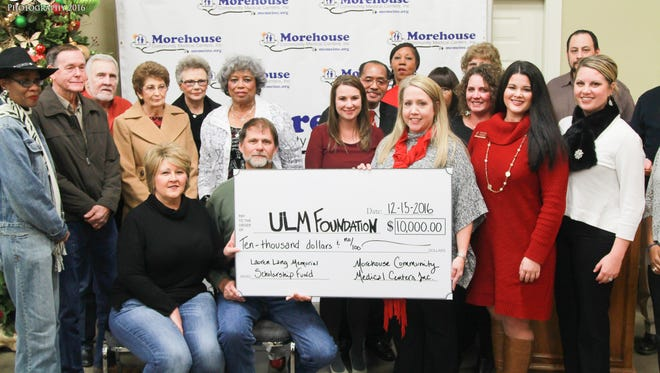 Lauren Lang Memorial Scholarship Funch check presentation at ULM