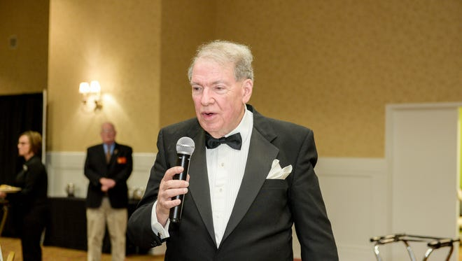 Ex-U.S. Rep. Charles Taylor at his annual holiday dinner in 2017. Taylor's Russian bank lost its license, with regulators saying it violated rules against money laundering and inflated the value of its assets.