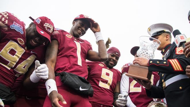 Freshman quarterback James Blackman reacts to being awarded the offensive player MVP award during post-game celebrations. The Florida State Seminoles defeated the Southern Mississippi Eagles 42-13 at the Independence Bowl.