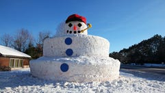 Snowmy Kromer, a 30-foot-tall snowman, stands outside