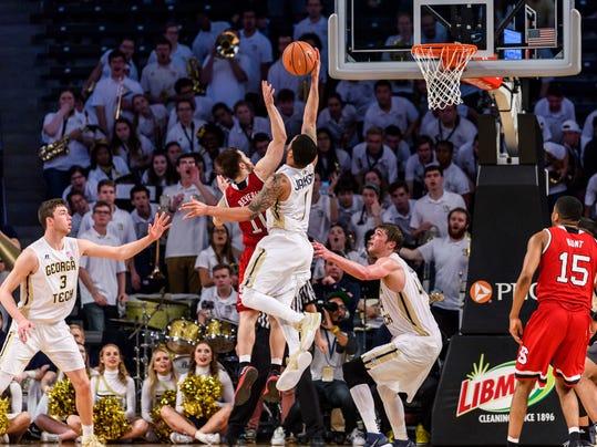 Georgia Tech guard Tadric Jackson (1) blocks a shot by North Carolina State guard Braxton Beverly (10) in the second half of an NCAA college basketball game, in Atlanta, Thursday, March 1, 2018. (AP Photo/Danny Karnik)