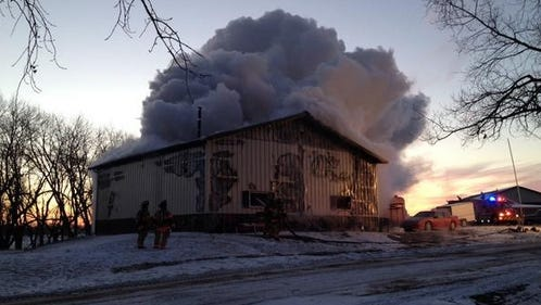 Smoke billows from a garage fire on North Daisy Avenue in northwestern Sioux Falls on Thursday, Nov. 20, 2014.
