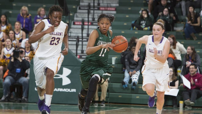Binghamton University sophomore guard Imani Watkins dribbles  past University at Albany defenders in Sunday's America East Conference semifinal game in the Events Center. Watkins scored a team-high 14 points, but Albany won 79-43.
