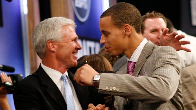 Curry hugs Davidson coach Bob McKillop during the 2009 NBA draft.