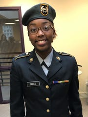 First Sergeant and ballet dancer Asya Miles, in uniform