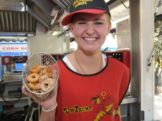 Heather Jensen of Des Moines, IA shows off her donuts