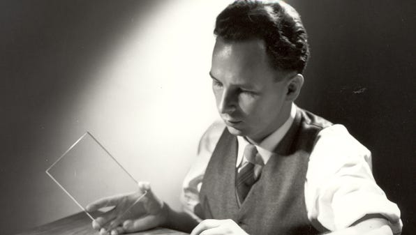 Don Stookey, shown here in 1950, prepares to expose an image to ultraviolet light.