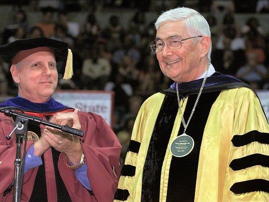President T.K. Wetherell, left, presents Steve Edwards