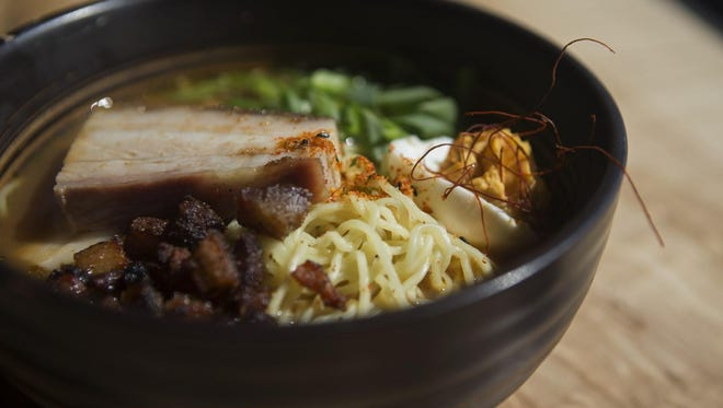 Tochi Ramen topped with slices of pork belly, green onion and a spicy miso deviled egg.