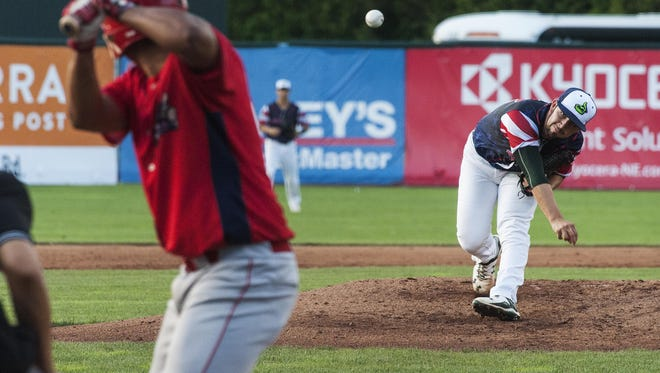Vermont starting pitcher Brandon Bailey (12) delivers a pitch during the baseball game between the Williamsport Crosscutters and the Lake Monsters at Centennial Field on Thursday night in Burlington.