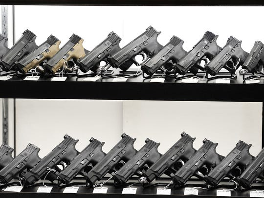 Guns in a showcase.