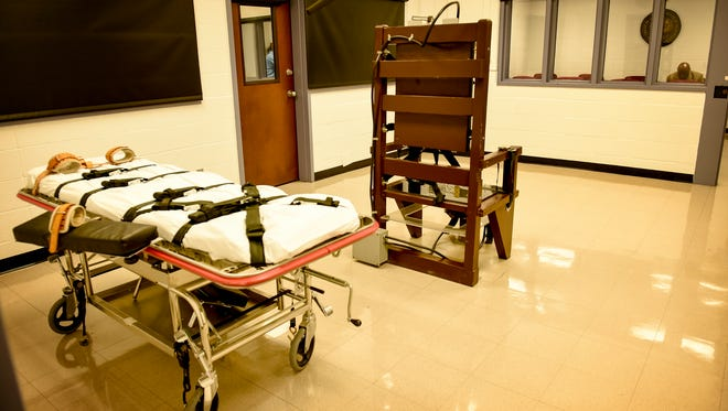 The gurney and electric chair sit inside the execution chamber connected to the witness gallery Thursday, March 2, 2017, at the Riverbend Maximum Security Institution in Nashville, Tenn.