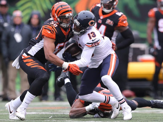 Cincinnati Bengals linebacker Jordan Evans (50) tackled Chicago Bears wide receiver Kendall Wright (13) during the Week 14 NFL game between the Chicago Bears and the Cincinnati Bengals, Sunday, Dec. 10, 2017, at Paul Brown Stadium in Cincinnati. Chicago won 33-7.