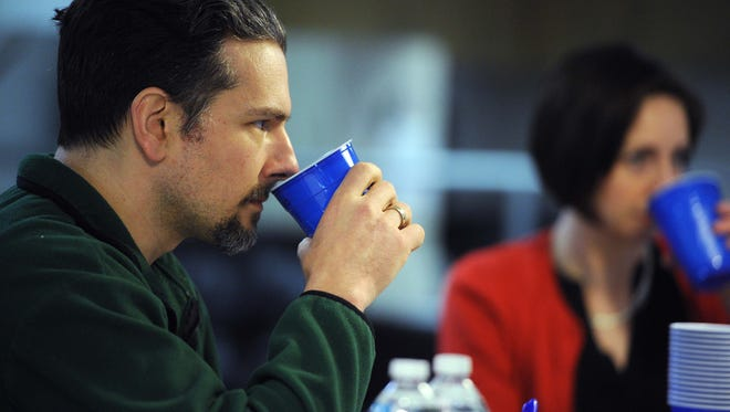 Marcus Strawhorn is seen judging a beer tasting project at the Star Friday April 4, 2014.