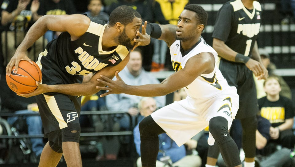 Anthony Clemmons, right, is in the face of Purdue's