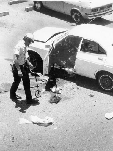 Investigators examine the car of Don Bolles, investigative reporter for The Arizona Republic, who died on June 13, 1976, of injuries received in a car bomb attack on June 2, 1976.
